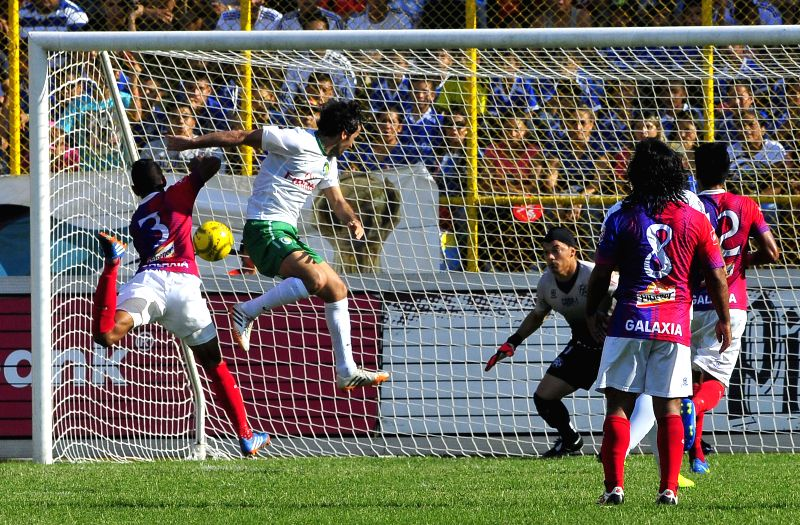 Raul Gonzalez Blanco (2nd L) of New York Cosmos heads the ball to score during a friendly match against El Salvador's Club Deportivo FAS held at Cuscatlan ...