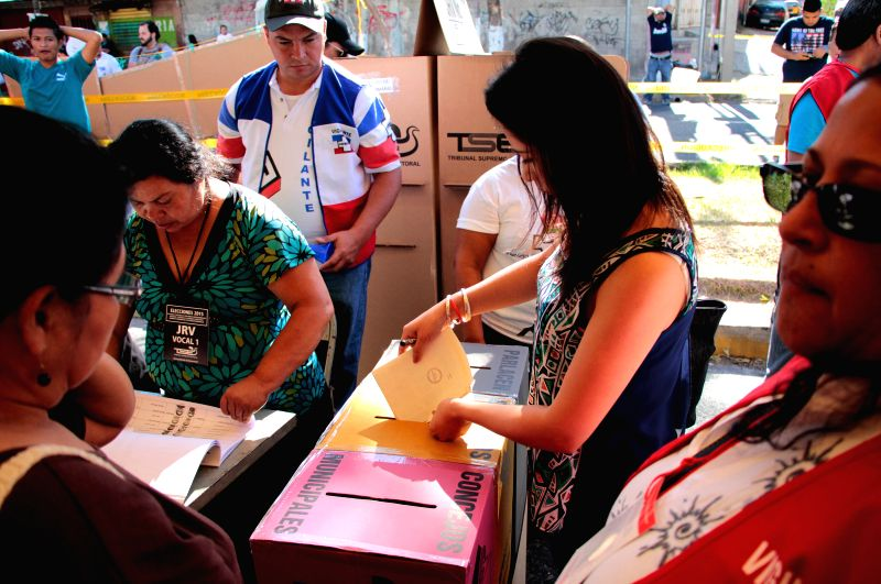 A woman casts her vote during the municipal and parliamentary elections at a polling station in San Salvador, capital of El Salvador, on March 1, 2015. ...