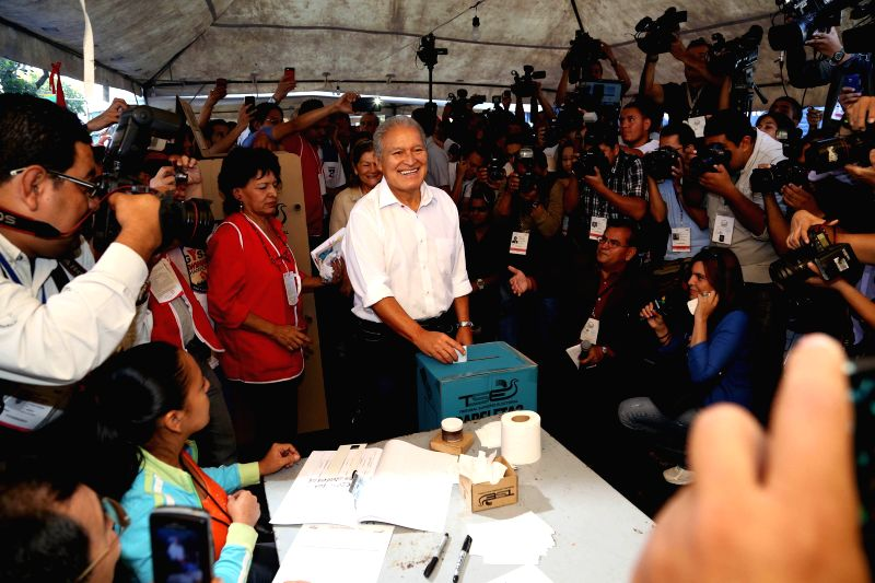 Image provided by El Salvador's Presidency shows President Salvador Sanchez Ceren (C) casting his vote during the municipal and parliamentary elections at a ...