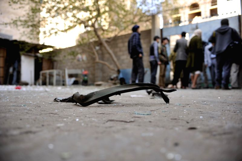 A piece of wreckage is seen at the explosion site at the house of a Shiite Houthi leader in central Sanaa, Yemen, on Dec. 8, 2014. At least eight people were wounded when two explosive devices