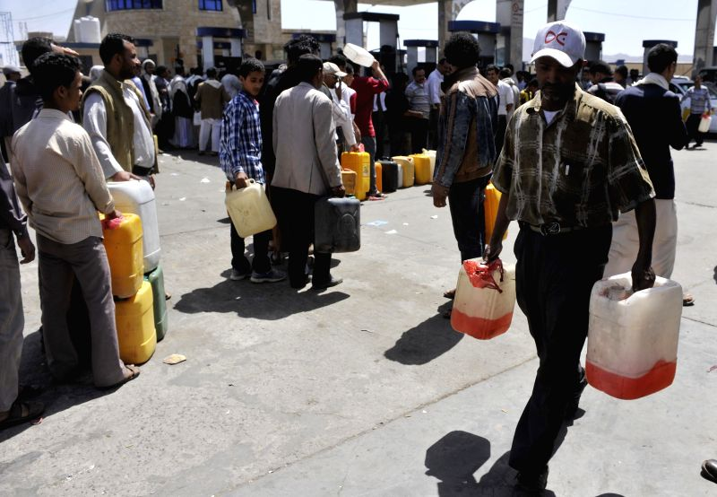 A Yemeni leaves a gas station with his petrol in Sanaa, Yemen, April 21, 2014. Frequent attacks on Yemen's oil pipelines have caused reduction in oil export and fuel