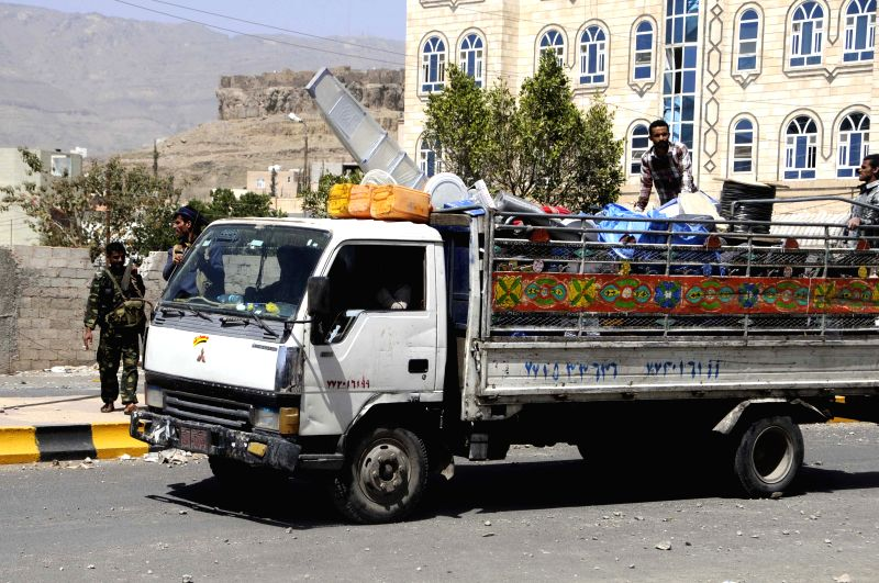 A Yemeni family moves furniture to rural areas due to the Saudi-led airstrikes in Sanaa, Yemen, on April 21, 2015. The Saudi-led coalition forces continued ...