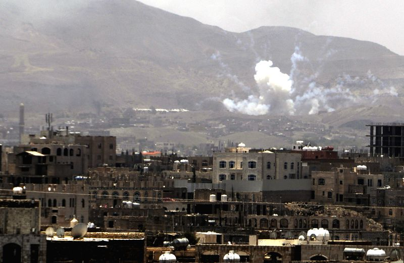 Smoke rises after the Saudi-led airstrikes hit a military camp in Sanaa, Yemen, on April 21, 2015. The Saudi-led coalition forces continued airstrikes in Yemen on ...