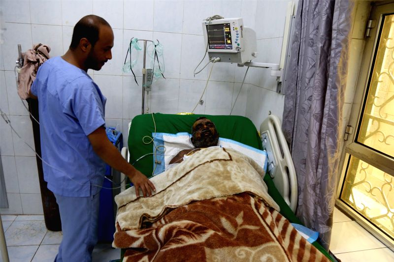 SANAA, Aug. 10, 2018 - A Yemeni man receives medical treatment after he was wounded in airstrikes in Hodeidah, at a hospital in Sanaa, Yemen, on Aug. 10, 2018. The Saudi-led coalition airstrikes ...