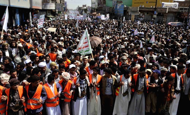Yemeni protesters take part in a demonstration in Sanaa, Yemen, on Aug. 18, 2014. Tens of thousands of Yemeni protesters  supporting the Shiite Houthi group take part