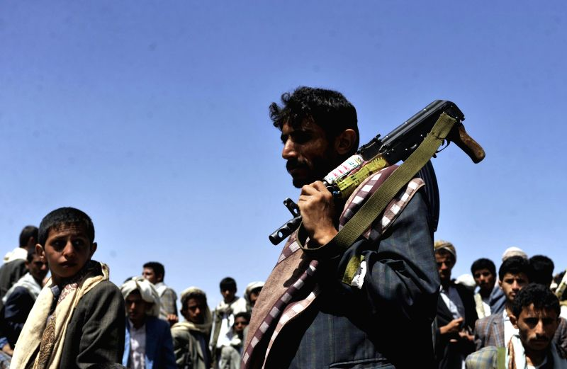 A fighter of the Shiite Houthi participates in a rally demanding the resignation of Yemeni government at the Hamdan area, about 30 km north of the capital of Sanaa, ..