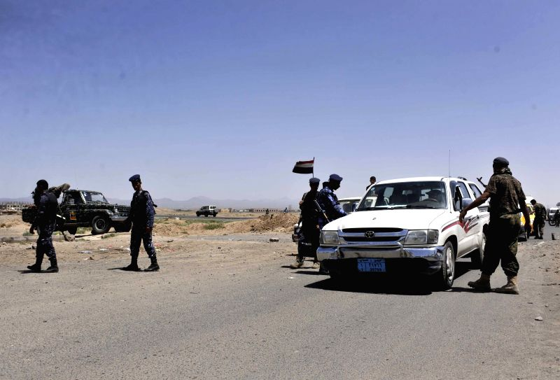 Yemeni soldiers guard a checkpoint and check cars at an entrance to Sanaa, Yemen, on Aug. 21, 2014. The Yemeni army on Thursday deployed soldiers at all entrances to .