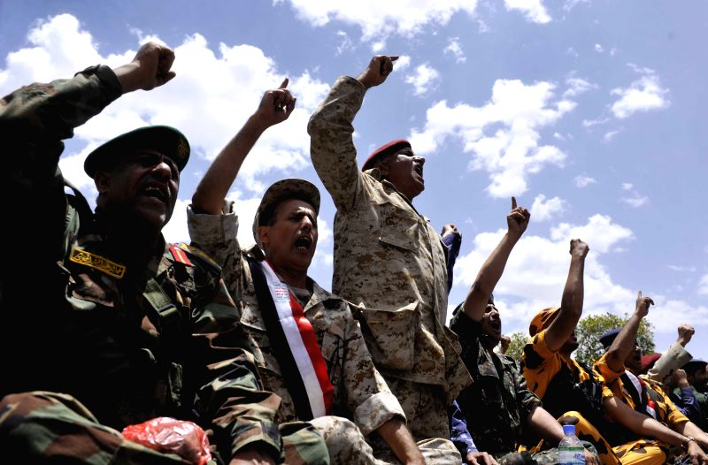 Yemeni protestors shout slogans during a mass rally in Sanaa, Yemen, on Aug. 22, 2014. Tens of thousands of protestors, most of them supporters of the Shiite Houthi ..
