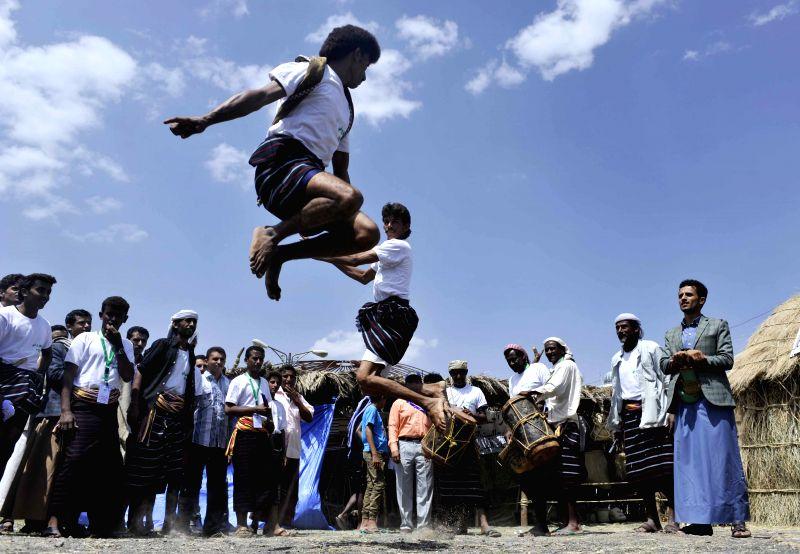 Yemeni men perform traditional dance during the one-week Sanaa Summer Festival in Sanaa, Yemen, on Aug. 25, 2014. Yemen launched the 7th Sanaa Summer Festival in the .