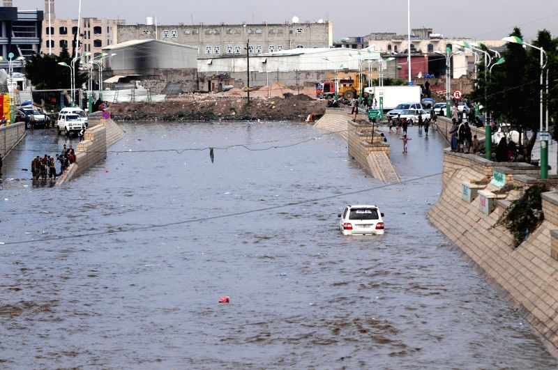 SANAA, Aug. 6, 2018 - Photo taken on Aug. 6, 2018 shows a car trapped in a flooded area in Sanaa, Yemen. Heavy rain hit Sanaa on Monday afternoon, causing flooding and traffic disruption inside the ...