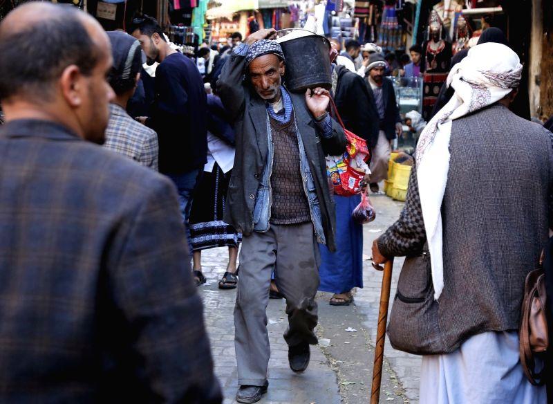 SANAA, Dec. 6, 2018 - Yemeni people shop on a local market in Sanaa, Yemen, on Dec. 6, 2018.