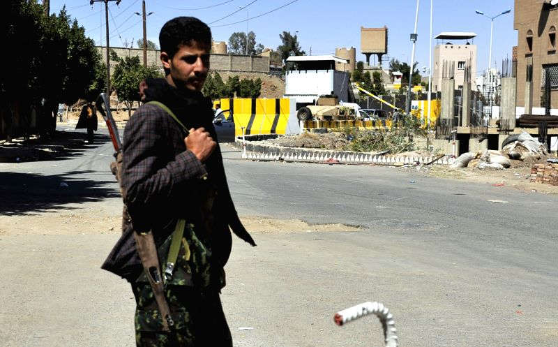 A Houthi fighter stands outside the house of former President Abd-Rabbu Mansour Hadi who  is guarded by the Houthi fighters in Sanaa, Yemen, Feb. 21, 2015. Yemen's ...