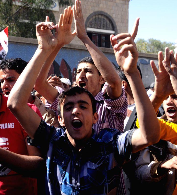Yemeni protesters shout slogans during a demonstration to demand former President Abd-Rabbu Mansour Hadi's return to power in Sanaa, Yemen, Feb. 21, 2015. Yemen's ...