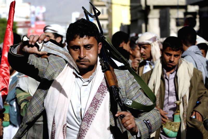 Supporters of the Shiite Houthi group take part in a demonstration against the foreign interference in Sanaa, Yemen, Feb. 27,  2015. Thousands of pro-Houthi ...