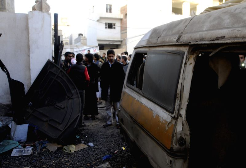 A car is damaged as two explosive devices went off outside a house of a Houthi leader in Sanaa, Yemen, on Jan. 23, 2015. Yemen's president and prime minister Thursday - Thursday