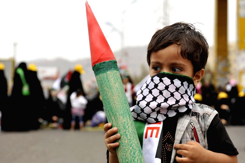 A Yemeni child holds a model of a missile when he takes part in a demonstration against the Israeli attack on Gaza, in Sanaa, Yemen, on July 25, 2014. Tens of ...
