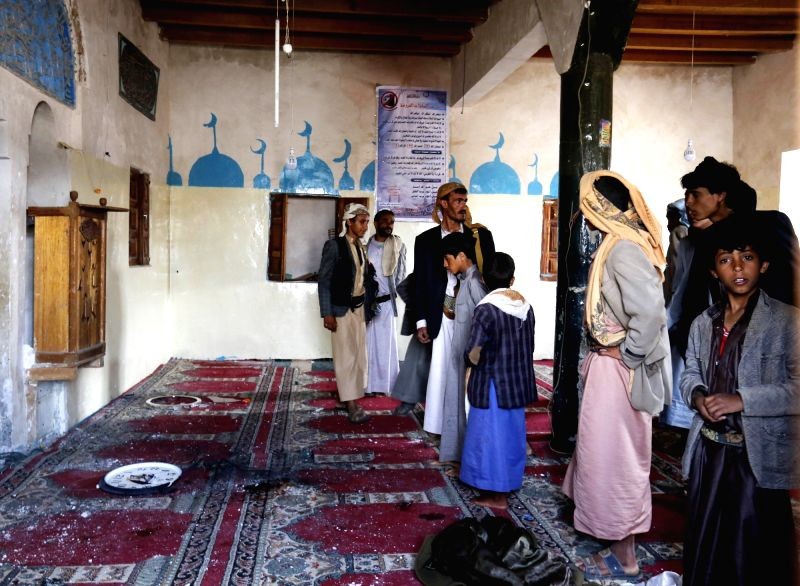SANAA, July 27, 2016 - People inspect the mosque attacked by a gunman in Yemen's capital of Sanaa on July 27, 2016. A gunman threw grenades and opened fire on worshipers at a mosque in Sanaa late on ...