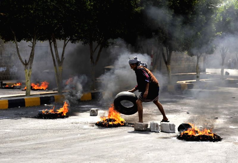 A Yemeni burns tires to protest against the decision of the government to dramatically increase the fuel price in Sanaa, Yemen, on July 30, 2014. The Yemeni ...