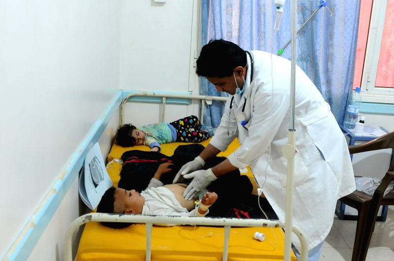 SANAA, July 31, 2018 - A doctor checks cholera-infected children as they receive treatment at a separated cholera department in a hospital in Sanaa, Yemen, on July 31, 2018. According to the recent ...