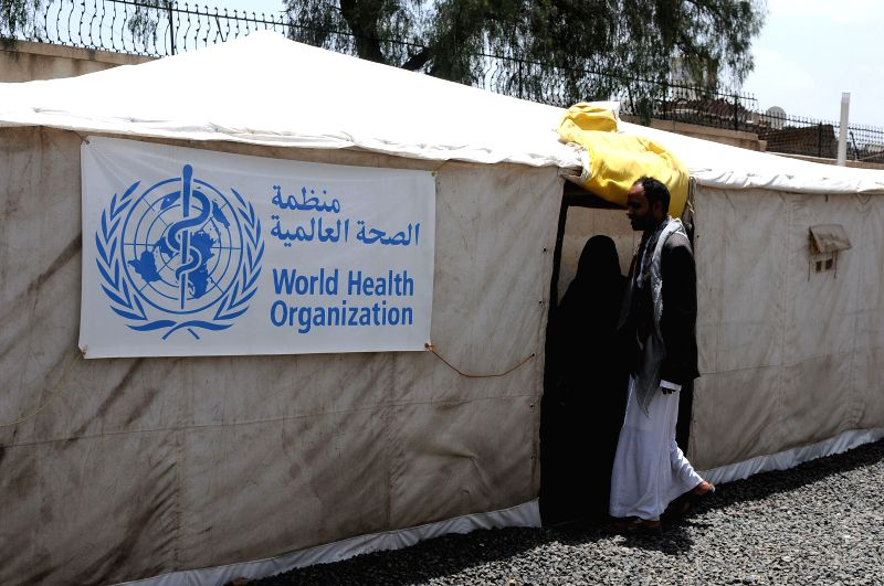 SANAA, July 31, 2018 - A man enters a tent for treating cholera-infected people at a separated cholera department in a hospital in Sanaa, Yemen, on July 31, 2018. According to the recent data ...