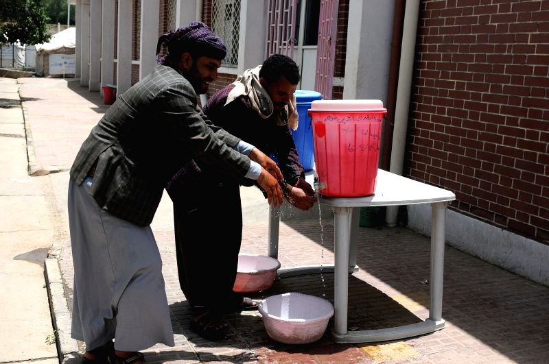 SANAA, July 31, 2018 - People wash their hands with anti-cholera disinfectant at a separated cholera department in a hospital in Sanaa, Yemen, on July 31, 2018. According to the recent data released ...