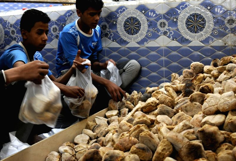SANAA, June 7, 2017 - Volunteers prepare to distribute bread for poor families who were affected by the ongoing crisis and unpaid salaries at a charity bakery, in Sanaa, Yemen, on June 7, 2017. The ...