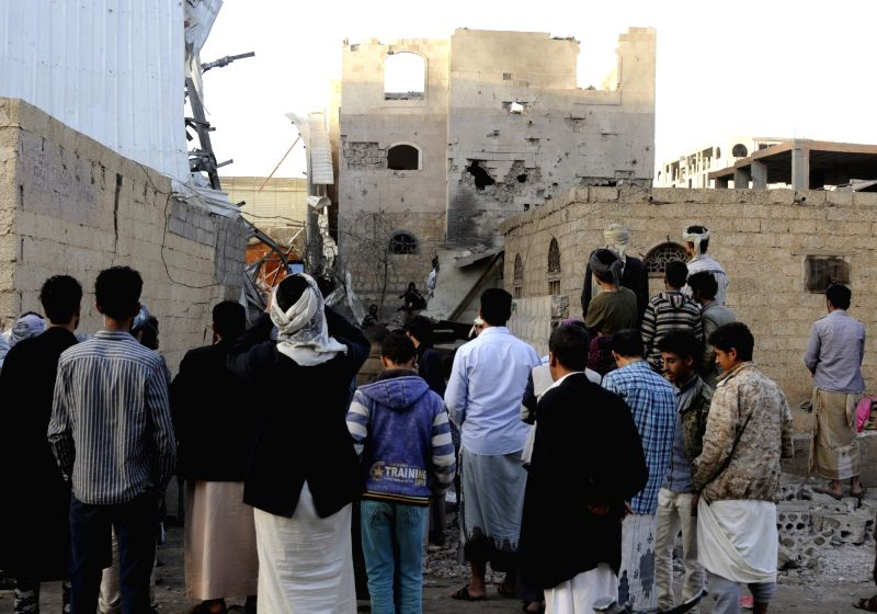 SANAA, June 9, 2017 - People gather around the rubble of a building which was damaged in an airstrike in Sanaa, Yemen, June 9, 2017. Two children and a woman were killed and two others injured in the ...