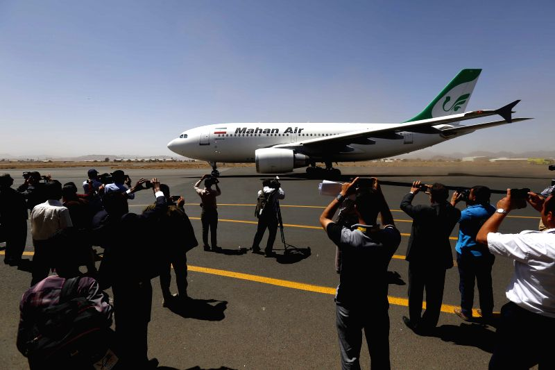 A plane of Iran's Mahan airliner with humanitarian and medical aid lands in Sanaa International Airport in Sanaa, Yemen, March 1, 2015. An Iranian passenger plane ...