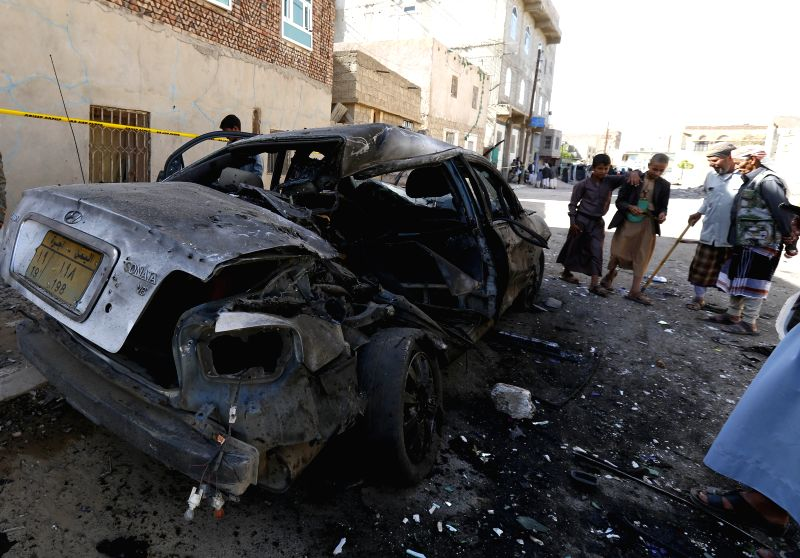 People gather outside a mosque which was hit by a suicide bombing attack in Sanaa, Yemen, on March 20, 2015. The Islamic State (IS) claimed responsibility in an ...