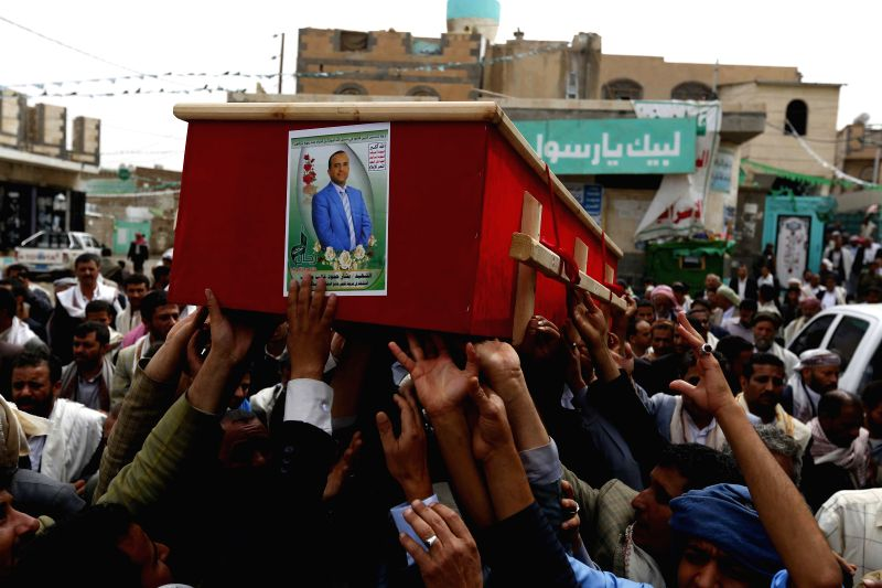 People carry a coffin during a funeral for victims in the suicide bombing attacks on mosques on Friday in Sanaa, Yemen, on March 23, 2015. The Yemeni people held a ...