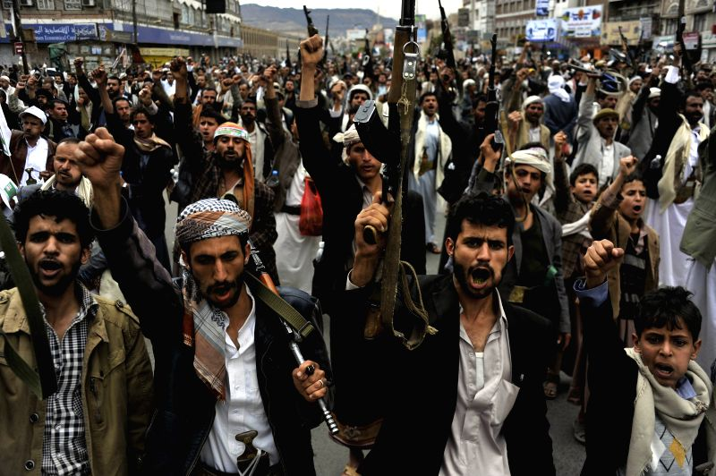 Supporters of the Shiite Houthi group shout slogans during a rally in Sanaa, Yemen, on March 26, 2015. The Shiite Houthi group organized a demonstration in Sanaa to ...
