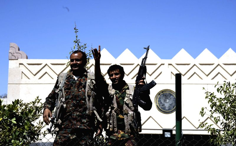 Two Yemeni soldiers stand in front of the U.S. embassy as the Yemeni authorities ordered to remove barriers, which were set up in front of the embassy after it was ...