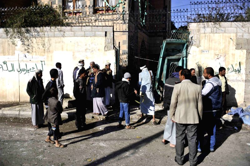 People gather around the explosion site at the house of a Shiite Houthi leader in central Sanaa, Yemen, on Dec. 8, 2014. At least eight people were wounded when two explosive devices went off .