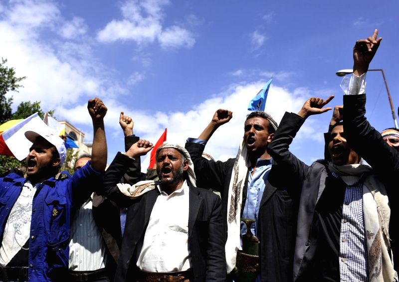 Yemeni protestors shout slogans during a demonstration in Sanaa, Yemen, on Sept. 1, 2014. Thousands of supporters of the Shiite Houthi group rallied in Sanaa, ...