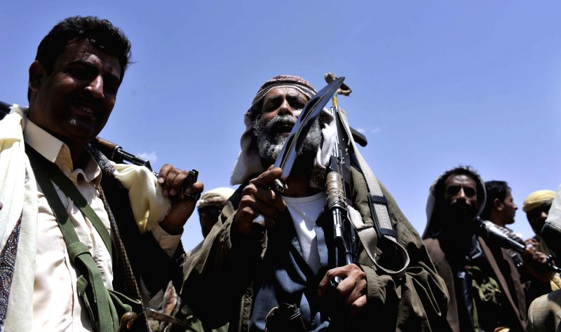 Fighters loyal to the Shiite Houthi group gather at a camp outside Sanaa, Yemen, on Sept. 2, 2014. Yemeni President Abd-Rabbu Mansour Hadi will replace the government