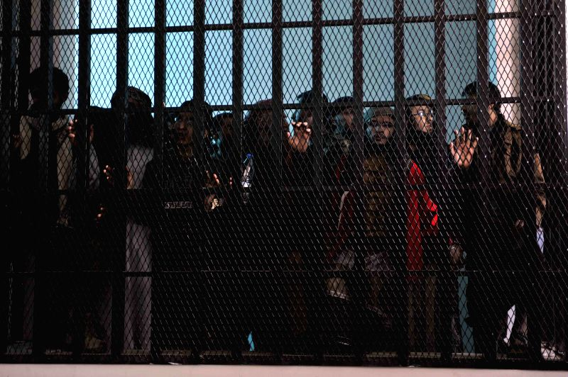 Sanaa (Yemen): Al-Qaida militants stand behind bars during a trial at the state security court in Sanaa, Yemen, Nov. 25, 2014. Yemen's state security court held a trial on Tuesday on 11 al-Qaida ...