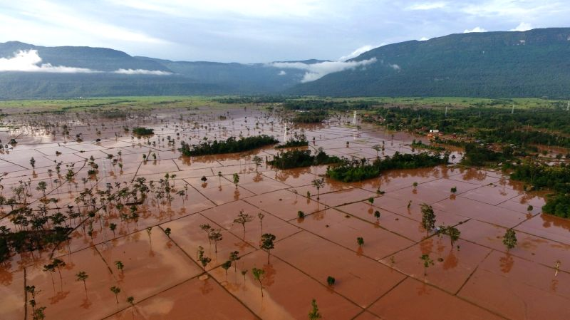 SANAMXAY, July 28, 2018 - Aerial photo taken on July 28, 2018 shows the flooded area after a dam collapsed in Sanamxay District, Attapeu, Laos. Six people were confirmed dead while 125 remained ...