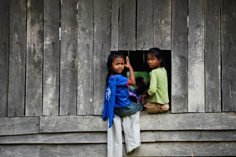 SANAMXAY (LAOS), July 27, 2018 Children are seen at a settlement after an under-construction dam collapsed in Sanamxay District, Attapeu Province, Laos, on July 27, 2018. Six people were ...