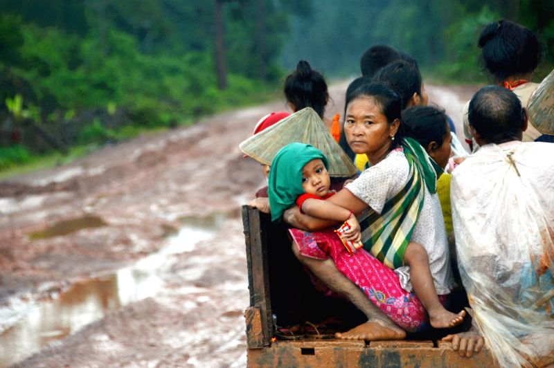 SANAMXAY (LAOS), July 27, 2018 Photo taken on July 27, 2018 shows villagers after an under-construction dam collapsed in Sanamxay District, Attapeu Province, Laos. Six people were ...