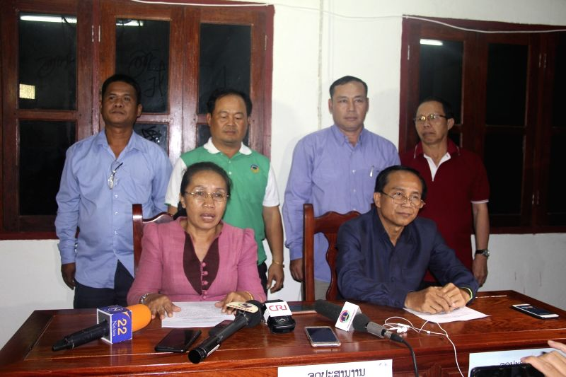 SANAMXAY (LAOS),  July 28, 2018   Minaphone Saisomphu(L, front), deputy secretary of the party committee of Attapeu Province, also deputy commander of the rescue operation, speaks during ...