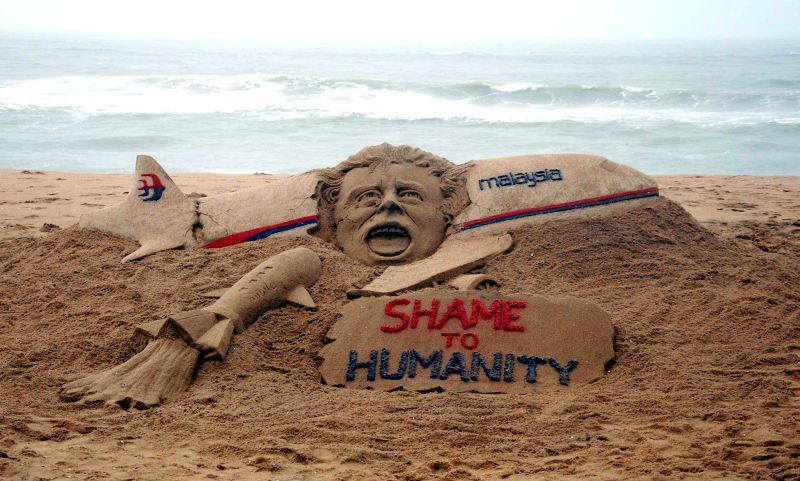 Sand artist Sudarsan Pattnaik's creation condemning the crash of Kuala Lumpur-bound Malaysia Airlines MH17 jetliner which crashed Thursday over Ukraine near the Russian border, with all the 298 ...