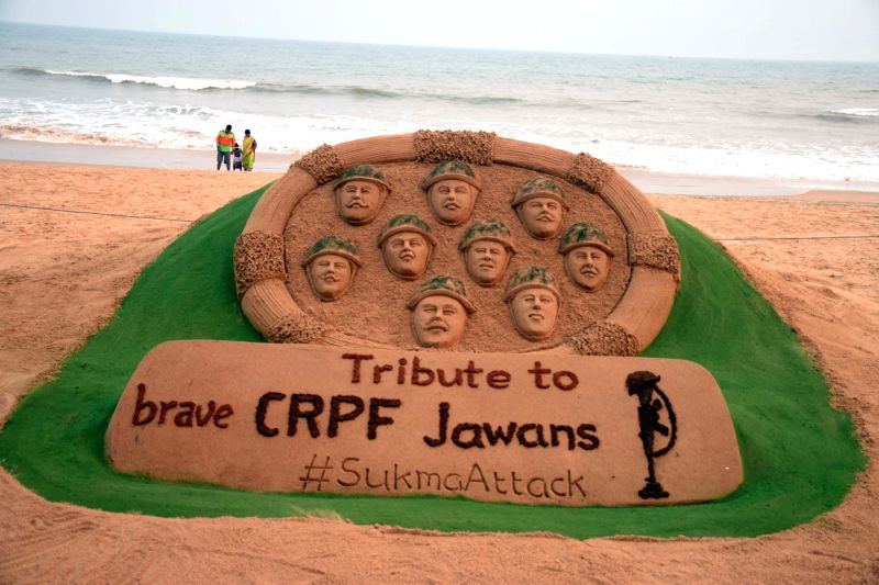 Sand artist Sudarsan Pattnaik's creation to pay tribute to CRPF personnel killed in Sukma Maoist attack at Puri beach, Odisha on March 13, 2018. At least nine CRPF personnel were killed and two ... - Sudarsan Pattnai