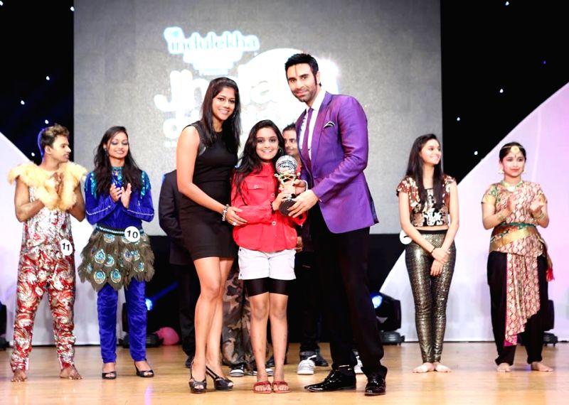 Sandip Soparrkar awarding contestant during `Jhalak Dikhhla Jaa UAE Season 3` grand finale at the Sheikh Rashid Auditorium, Indian High School in Dubai on June 24, 2014.
