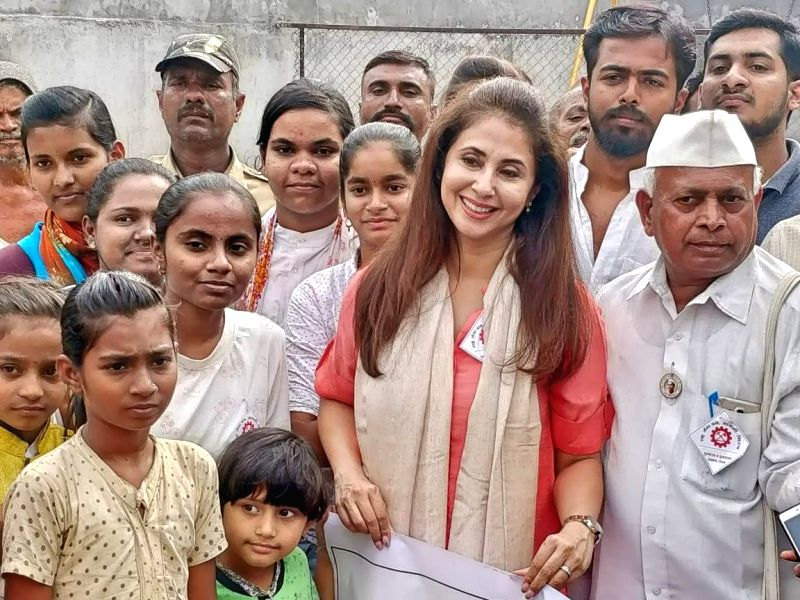Sangli: Actress and Congress leader Urmila Matondkar during her visit to a relief camp in Maharashtra's flood affected Sangli on Aug 14, 2019. The actress spent some time with the flood victims and distributed relief material.