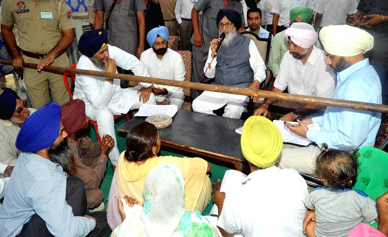 Punjab Chief Minister Parkash Singh Badal interacts with people during a programme in Sangrur on May 31, 2015. - Parkash Singh Badal