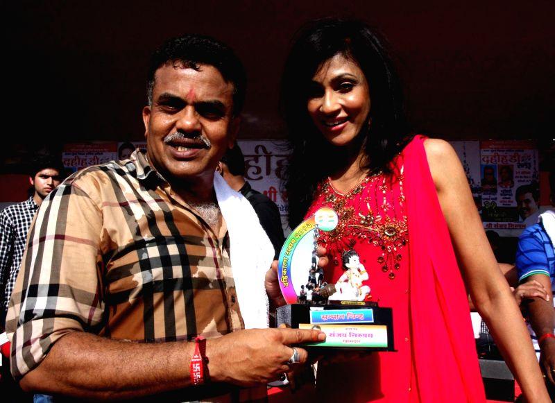 Sanjay Nirupam & Shandi Perera during Dahi Handi festival at Politician Sanjay Nirupam`s Dahi Handi in Mumbai on August 29, 2013.