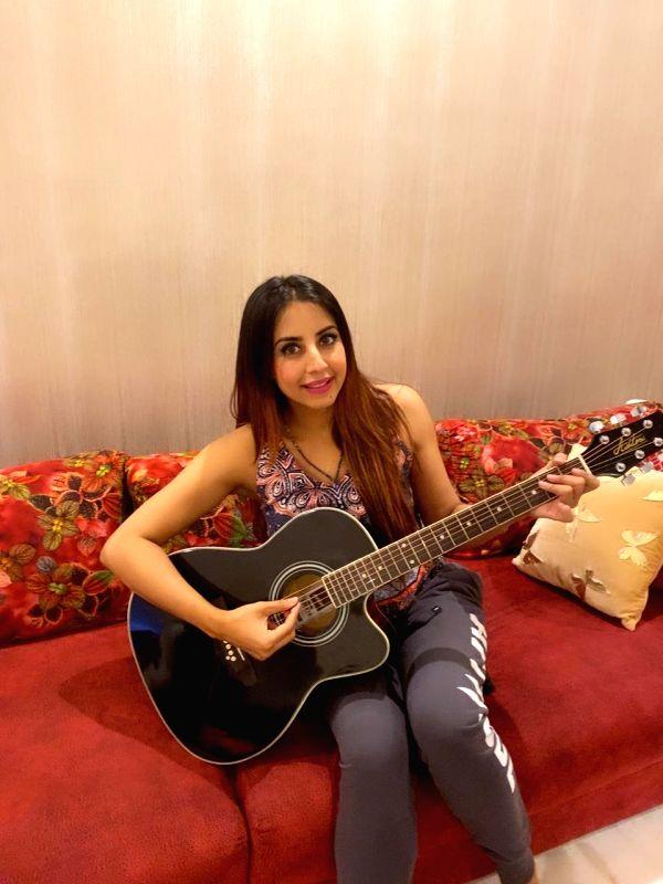 Sanjjanaa Galrani learns guitar during quarantine.