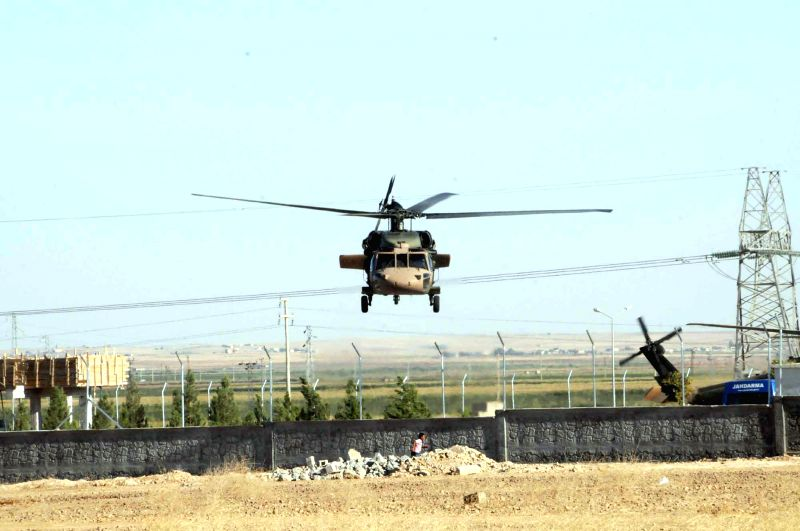 A Turkish military helicopter is seen at the border areas with Syria in Sanliurfa in Turkey, July 16, 2014. Turkey tightened security measures in its border areas