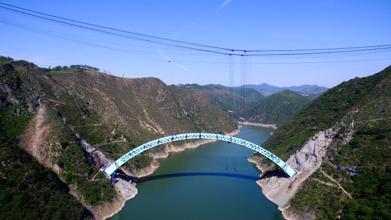 SANMENXIA, April 30, 2017 - Aerial photo taken on April 30, 2017 shows Luohe Bridge after closure of arch rib along the under-construction railway spanning from north China's Inner Mongolia ...