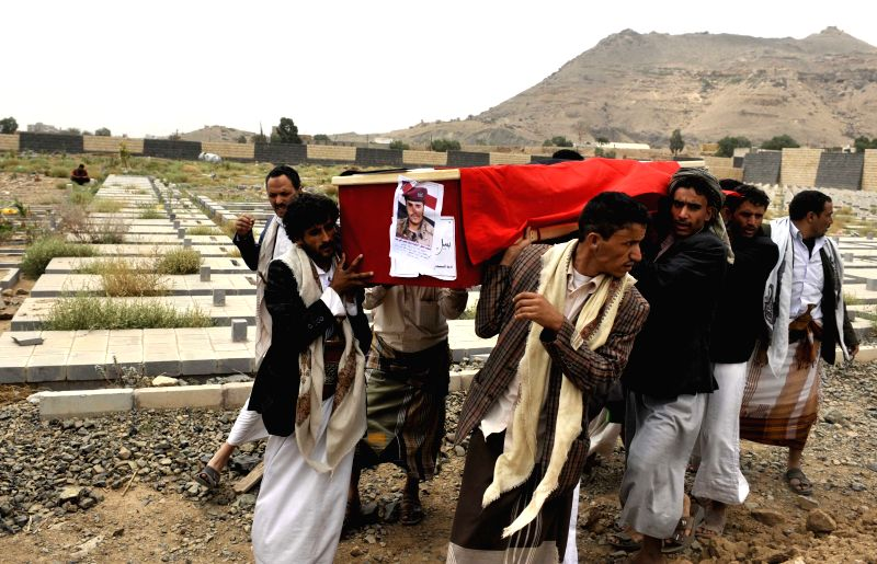 Yemenis carry a coffin of the soldier who was killed in the fighting with Shiite Houthi rebels in the northern Amran province during a funeral procession in Sanaa, ...